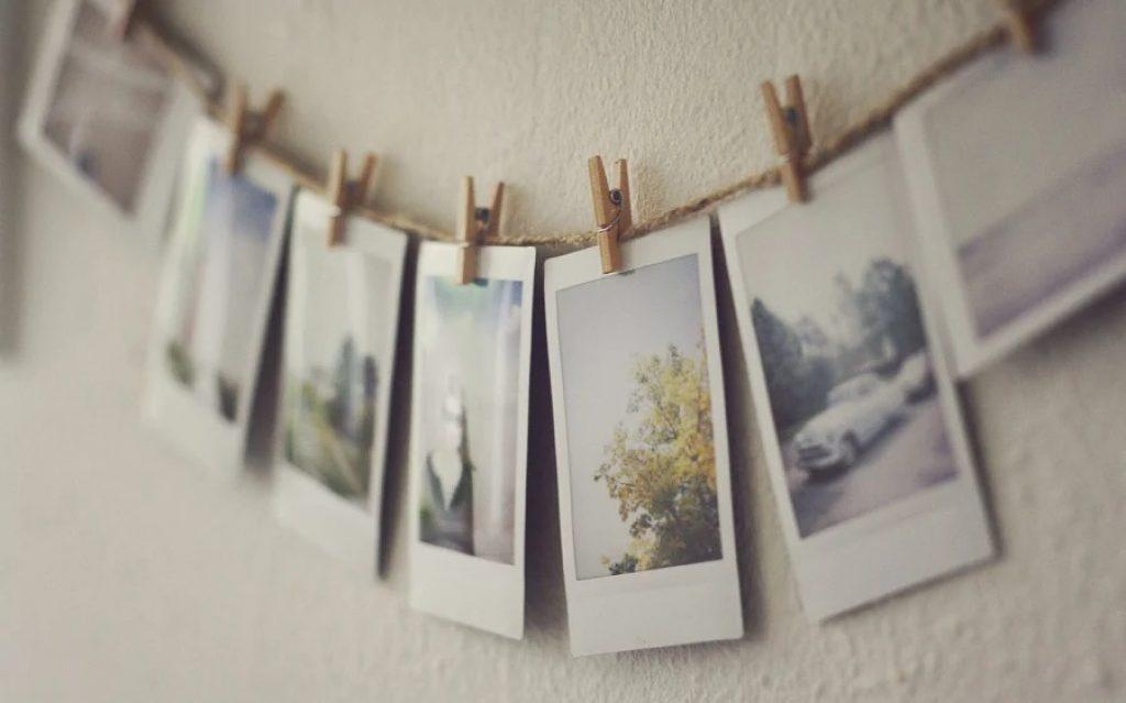 Design de perete cu imagini pe clești de rufe